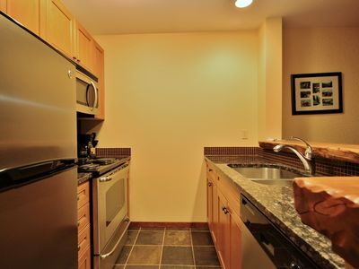 Photo for Ski-in/ski-out condo with kitchen, access to pool, hot tub and BBQ, free wifi, heated garage: S206