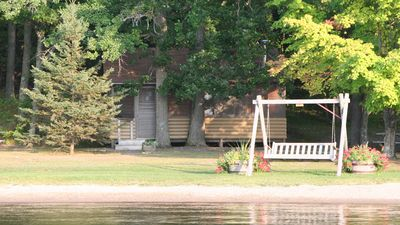 Lakeside swing is perfect place to enjoy a good book or watch the kids play.