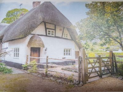 Photo for Charming  3 bedroomed Thatched cottage in rural village