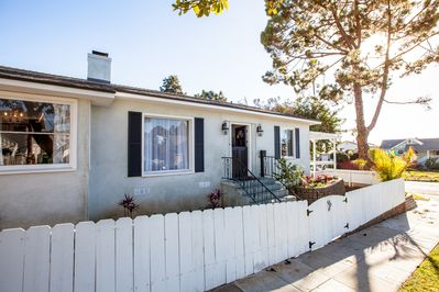 Vintage California charm with a white picket fence and a dutch door!