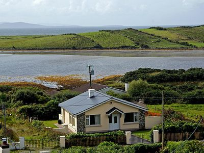 Photo for Detached bungalow (near to 268) in fine location enjoying extensive views over island studded…