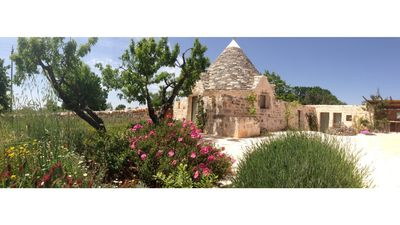Photo for Il Guardiano, refined trullo with swimming pool in Valle d Itria surrounded by nature