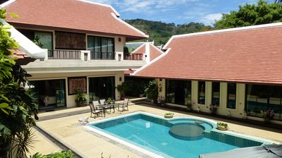 Photo for All buildings are set in a beautiful tropical garden around the private pool