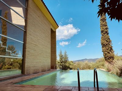 Photo for Designer villa with large pool, views and golf course within walking distance