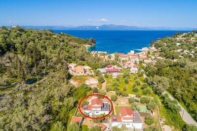 Aerial shot showing location of Villa Mia and view towards Loggos
