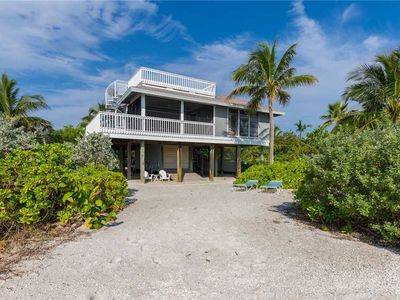 Photo for PICTURESQUE BEACHFRONT COTTAGE BEAUTIFUL VIEWS OF THE BAY, PRIVATE FISHING DOCK