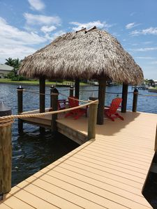 Enjoy our NEW Tiki Hut and Dock! Wonderful canal breezes all year long!