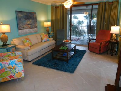 family room adjacent to dining area and balcony overlooking pool and beach