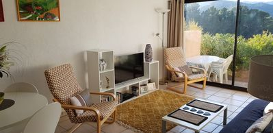 Photo for Apartment with terrace, pool, parking and wonderful views. Five minutes to beach