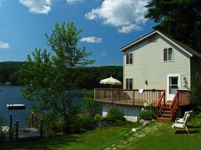 Relaxing lakeside living on 1.5 acres with 200' of shoreline,swim raft & gardens