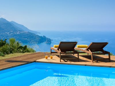 Photo for Private Hillside lux villa with pool and panoramic sea views above Agios Gordios