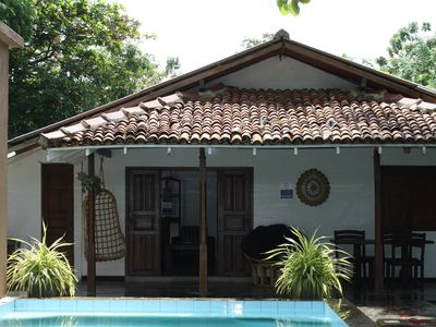 Photo for Self-contained villa with swimming pool and beautiful lagoon view, 50m to beach