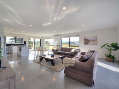 Photo for A 5 minute walk to beach or golf course. Free wifi. Sundeck & BBQ. Newly built.