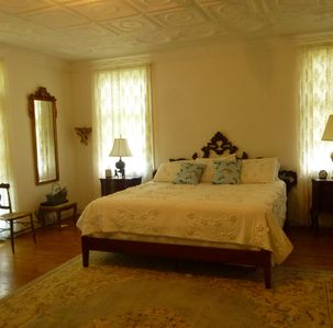 A large master bedroom suite offers a comfortable area for rest and relaxation.