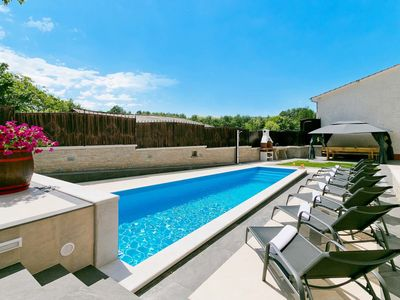 Photo for This 4-bedroom villa for up to 8 guests is located in Pazin and has a private swimming pool, air-con
