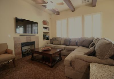 Sectional sofa and large flat-screen TV in the living room.