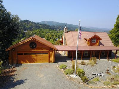 Photo for Semi- secluded log cabin Private River Access! No Internet Access or Pets.