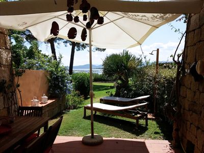 Photo for Porto Coda Cavallo Three-room apartment with garden 500 meters from the sea