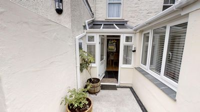 Fully enclosed courtyard with gate to driveway