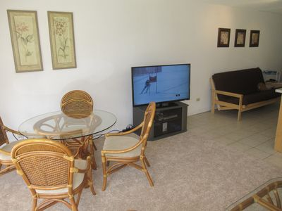 50 inc flat screen tv, blue ray did player,  full size futon and dinner table
