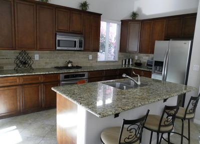 Kitchen, featuring stainless steel appliances and granite counter tops