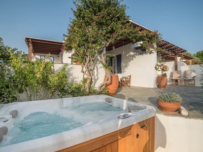 Photo for Delightful house with hot tub, 100m from amazing beach, sleeps 8 people