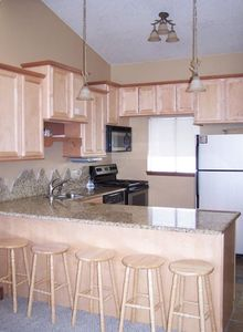 Newly remodeled kitchen with slab granite counters, dining area seats 13