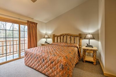 Enjoy restful slumbers in this first bedroom housing a king bed.