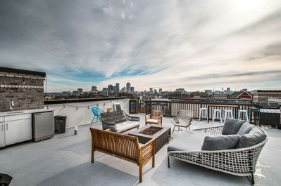 Enjoy a beer around the fire or a corn hole tournament on the rooftop terrace