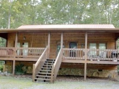 Photo for Secluded, dog-friendly cabin w/ private hot tub - close to town!