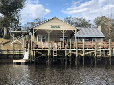 Photo for Cozy Waterfront Home! 2BR/2BA Large covered deck*fishing dock*floating boat dock