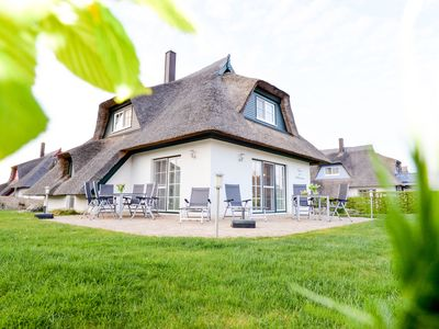 Photo for This new luxury thatched house, fireplace, sauna, jacuzzi, sun terrace, Wi-Fi