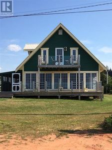 Photo for Unique Beach House Only Steps Away From Quiet North Shore Beach & Close To Golf Course