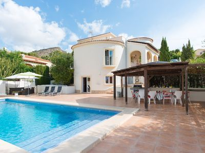 Photo for Family-friendly 4 min walk to El Portet beach with big, heated pool, sleeps 12+