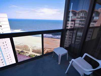 Photo for Colorful, upscale 2 bedroom oceanfront condo with WiFi, 2 pools, a tiki bar, a sun deck, a game room, impeccable style, and a partial ocean view located uptown and just steps to the beach!