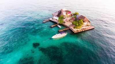 Photo for An unforgettable private house surrounded by turquoise water.