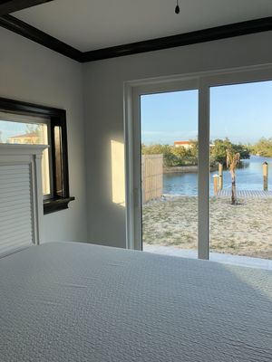Photo for GoldenEye Lodge, new house on canal w/ private 60' dock, beach access.