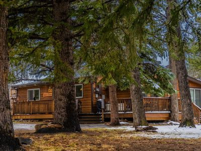 Photo for Riverfront 3BR cabin w/ hot tub 2 blocks to town