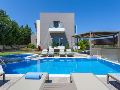 Photo for Unique designed villa with heated pool, gym & playroom in the heart of the city!