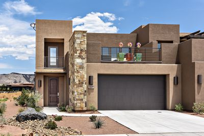 Front View - Peace On The Green is a 2700 sq foot luxury villa located on the 18th Green at The Ledges Golf Club.  The surrounding landscapes, views of Snow Canyon State Park, spacious rooms, and expansive roof patio make this home a premier destination for your next vacation.
