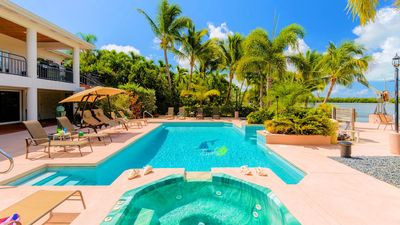 This property has it all pool, Jacuzzi and boating canal.
