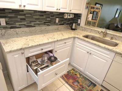 Custom cabinetry with pull out deep drawers, filled with everything you need!