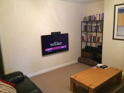 Lounge with large flat-screen TV, surround sound, books, DVDs and games