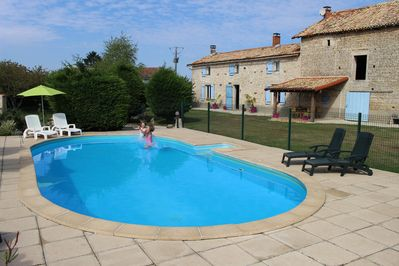 Heated 10m x 5m gated pool and sun terrace with loungers