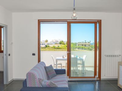 Photo for Elegant and refined three-room apartment in a residence facing the beaches of Torre Lapillo.