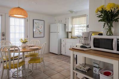 Fully equipped kitchen opens on to the deck for al fresco dining