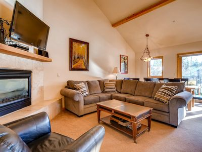 Photo for Spacious condo w/ large deck, shared hot tub, free WiFi, and gas fireplace!