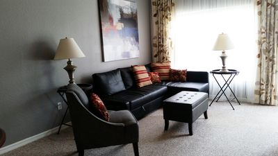 """Spacious and comfortable living room, with pull out sofa bed. 50"""" flat screen TV"""
