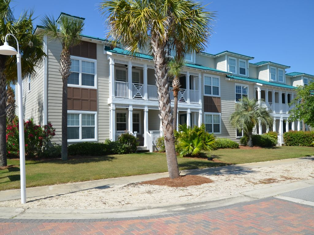 This beautiful 2 bedroom pet friendly town home -- Vacation Villa -- is located in Woodland Shores, Destin FL. 5 minute walk to the beach, 20 steps from the heated pool. Quiet corner unit with front and back patio and 2nd floor balcony at the master bedroom. 2 assigned parking spaces right by the front door. Free beach service in season (March - October).