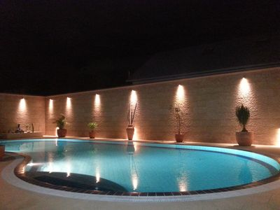 Tiled overflow heated swimming pool